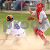 Beck Diefenbach  -  bdiefenbach@daily-chronicle.com<br /> <br /> Genoa-Kingston Craig Billington (8) slides safe into home as Oregon catcher Dan Gale (2) misses the throw during the third inning of the game against at GK High School in Genoa, Ill., on Monday May 18, 2009.