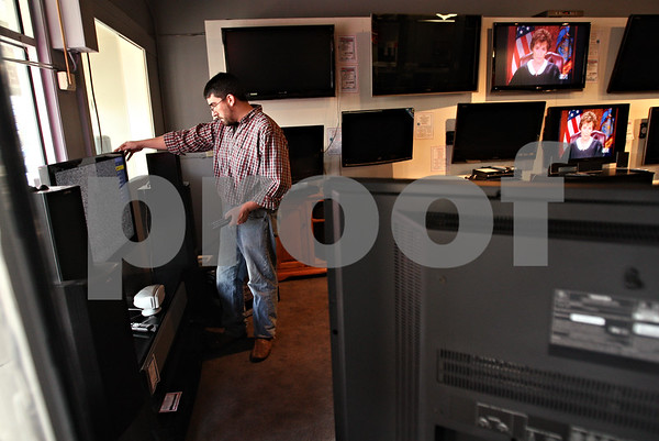 Beck Diefenbach  -  bdiefenbach@daily-chronicle.com<br /> <br /> Electronics manager John Riley sets up a new Sharp LED television at Paulsen Appliance and Electronics in Sycamore, Ill., on Monday Nov. 30, 2009.