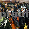 Beck Diefenbach  -  bdiefenbach@daily-chronicle.com<br /> <br /> DeKalb High School students react after it is announced that school will be cancelled for the next day. The students were attending the DeKalb boys basketball game against Batavia at DeKalb High School.