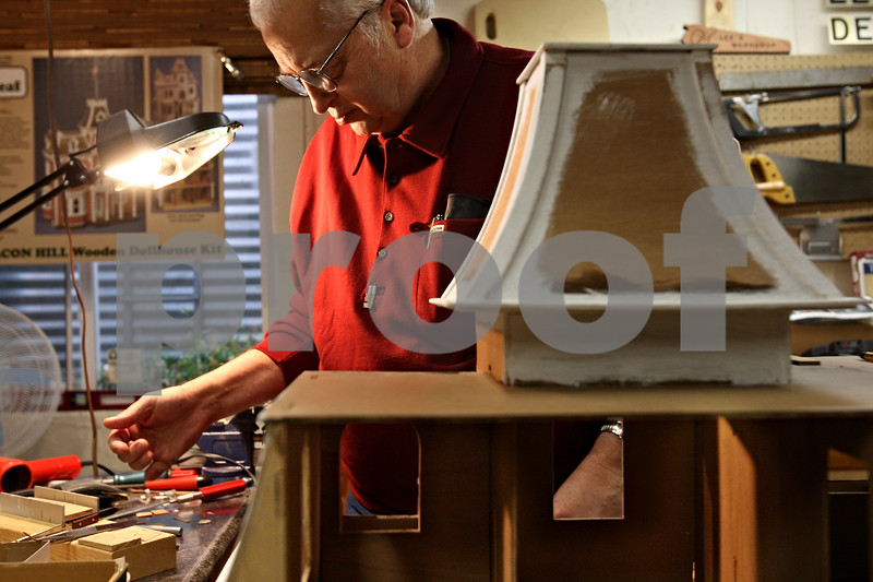 Beck Diefenbach  -  bdiefenbach@daily-chronicle.com<br /> <br /> Lee Newtson sifts through his various tools while constructing two doll houses in the basement of his Cortland, Ill., home on Monday Dec. 14, 2009. One of the doll houses will be delivered to the White House in Washington D.C. and the second will be sold to raise funds to benefit Fisher House which serves families of veterans at Hinds Veterans Affairs Hospital in Maywood, Ill.