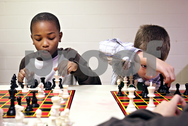Beck Diefenbach  -  bdiefenbach@daily-chronicle.com<br /> <br /> Fourth grader Cole Swafford, right, and third grader Johnny Brooks make their moves during chess club at Tyler Elementary School in deKalb, Ill., on Monday Dec. 7, 2009.