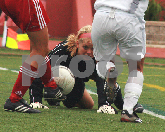 Randi Stella – rstella@daily-chronicle.com<br /> <br /> Chatham Glenwood's goalie Cara Moody eyes the ball during the 2A third place state tournament game at North Central College in Naperville, Ill., on Saturday, June 6th, 2009.