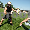 Rob Winner – rwinner@daily-chronicle.com<br /> Jason Keneway runs through drills with his teammates during a Hiawatha football practice.<br /> 08/12/2009