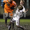 Rob Winner – rwinner@daily-chronicle.com<br /> In the second half, DeKalb's Eric Galvan kicks the ball down field before Freeport's Dylan Lutz can stop him during the IHSA Class 2A Freeport Sectional at Belvidere on Friday October 30, 2009. DeKalb lost to Freeport, 1-0.