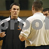 Beck Diefenbach  -  bdiefenbach@daily-chronicle.com<br /> <br /> DeKalb High School assistant coach Chad Pecka talks with head coach Dave Rohlman during practice at Huntley Middle School in DeKalb, Ill., on Thursday Jan. 22, 2008.