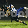 Beck Diefenbach  -  bdiefenbach@daily-chronicle.com<br /> <br /> Sycamore's Eric Ray (5) catches a long pass which lead to touchdown during the second quarter of the game against Geneva at Sycamore High School in Sycamore, Ill., on Friday Sept. 25, 2009.