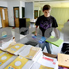 Rob Winner – rwinner@daily-chronicle.com<br /> Volunteer Tyrus Taylor, 14, helps sort donated school supplies on Thursday morning at the DeKalb Salvation Army.<br /> 07/28/2009
