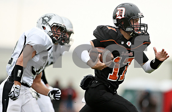 Rob Winner - rwinner@daily-chronicle.com<br /> <br /> DeKalb quarterback Frank Petras carries the ball during the first quarter.<br /> <br /> 10/10/2009
