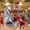 Beck Diefenbach – bdiefenbach@daily-chronicle.com<br /> <br /> Hinckley-Big Rock's Brian Michaels (12) and Indian Creek's Seth Sanderson (25) fight for a rebound during the first quarter of the game at H-BR High School in Hinckley, Ill., on Friday Feb. 20, 2009.