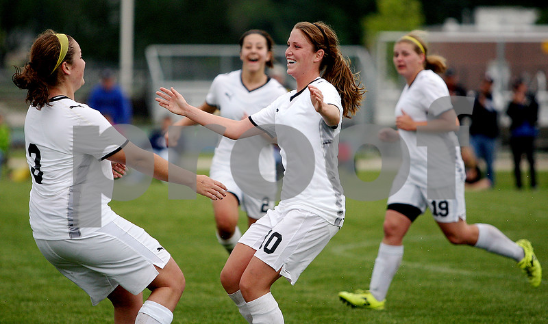 Rob Winner – rwinner@daily-chronicle.com<br /> Briana Henke (left) goes to hug Karissa Miller after an assist by Henke on Miller's header for Sycamore's third goal during the Class 2A Rochelle Supersectional on Tuesday. Sycamore went on to defeat Peoria Notre Dame, 5-0.<br /> 06/02/2009