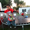 Beck Diefenbach  -  bdiefenbach@daily-chronicle.com<br /> <br /> Edwin Morales, 7, leaps off the trampoline as his friends play in their homes at Evergreen Village Mobile Home just east of Sycamore, Ill., on Thursday Sept. 3, 2009.