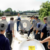 Rob Winner – rwinner@daily-chronicle.com<br /> From atop a railroad tank car, Edward Chapman, director of hazardous materials with Burlington Northern Santa Fe Railway, explains safety procedures to a group of first responders on Wednesday afternoon in DeKalb. The DeKalb Fire Department in cooperation with BNSF Railway and Union Pacific Railroad are hosting a first responder class this week.<br /> 07/15/2009