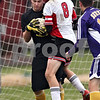 Beck Diefenbach  -  bdiefenbach@daily-chronicle.com<br /> <br /> Indian Creek's Matt Kyler (8, right) collides into Serena goal keeper Tyler Arnold during the second half of the class 1A regional match at Watermna Middle School in Waterman, Ill., on Wednesday Oct. 14, 2009. Serena defeated Indian Creek 1 to 0.