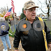 Rob Winner – rwinner@daily-chronicle.com<br /> Vietnam veteran Lonnie Stojan takes a break while placing flags along the sidewalk of the DeKalb County Courthouse in Sycamore on Friday October 30, 2009. Earlier this year, a tumor was found in his left lung, a presumptive after-effect caused by Agent Orange.