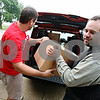 Rob Winner – rwinner@daily-chronicle.com<br /> Christ Community Church members including Chris Gingrich helped deliver school supplies to Chesebro Elementary School in DeKalb on Saturday morning.<br /> 08/08/2009
