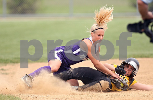 Beck Diefenbach  -  bdiefenbach@daily-chronicle.com<br /> <br /> Dixon third baseman Kara Devine (3) tags out Sycamore Samantha Navarro (4) during the bottom of the fifth inning of the game at Rochelle High School in Rochelle, Ill., on Tuesday May 26, 2009.