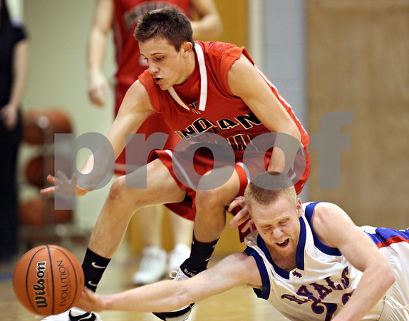 Beck Diefenbach – bdiefenbach@daily-chronicle.com<br /> <br /> Indian Creek's Trevor Foster (10) and Hinckley-Big Rock's Kyle Burks (20) crash into each other for a loose ball during the first quarter of the game at H-BR High School in Hinckley, Ill., on Friday Feb. 20, 2009.