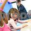 Beck Diefenbach  -  bdiefenbach@daily-chronicle.com<br /> <br /> Kindergardeners Cordelia Garnet, right, and Amari Johnson share a laugh as they write in their journals during the afternoon class at Jefferson Elementary School in DeKalb, Ill., on Wednesday April 29, 2009.