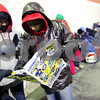 Beck Diefenbach  -  bdiefenbach@daily-chronicle.com<br /> <br /> (From left) Neefarika Seelam, Hari Ganesh and Priyam Shah, of DeKalb, look through a Best Buy ad sheet while waiting overnight for the store to open in DeKalb, Ill., on Friday Nov. 27, 2009.