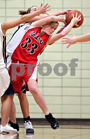 Beck Diefenbach  -  bdiefenbach@daily-chronicle.com<br /> <br /> Earlville-Leland's Taylor Hardin (33, front) nearly loses the ball despite multiple Hiawatha defenders during the second quarter of the game at Hiawatha High School in Kirkland, Ill., on Monday Dec. 14, 2009.