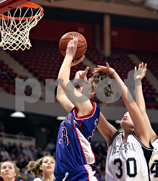 Beck Diefenbach – bdiefenbach@daily-chronicle.com<br /> <br /> Hinckley-Big Rock forward Tess Godhardt (33) shoots the ball through the hands of Winchester West Central High School center Tomi White (30) during the third quarter of the Class 1A IHSA State Basketball Championships at the Red Bird Arena in Normal, Ill., on Saturday Feb. 28, 2009.