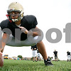 Rob Winner – rwinner@daily-chronicle.com<br /> Alex Calendo center for the Sycamore Spartans works out with his teammates during a recent practice.<br /> 09/29/2009