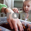 Beck Diefenbach – bdiefenbach@daily-chronicle.com<br /> <br /> Paige Walk, 5, examines a worm from the compost bin at Home Away from Home day care in DeKalb, Ill., on Thursday March 12, 2009. The class will use dirt from the compost bin in their garden in the spring.