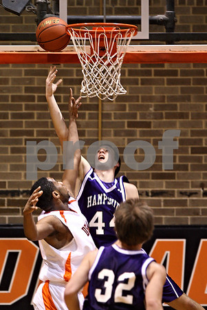 Beck Diefenbach  -  bdiefenbach@daily-chronicle.com<br /> <br /> Hampshire Tyler Watzlawick (44, center) shoots the ball above DeKalb's Craig Lane (40, left) during the second quarter of the game at DeKalb High School on Tuesday Dec. 22, 2009.  DeKalb defeated Hampshire 58 to 50.