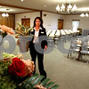 Rob Winner – rwinner@daily-chronicle.com<br /> Jennifer Muraski of Quiram Funeral Chapels in Sycamore places flowers around a casket this past Saturday morning before a service.<br /> 08/01/2009