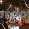 Beck Diefenbach  -  bdiefenbach@daily-chronicle.com<br /> <br /> DeKalb center Jordan Threloff prepares to shoot the ball during the fourth quarter of the game against Batavia at DeKalb High School in DeKalb, Ill., on Wednesday Jan. 14, 2008.