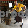 Rob Winner – rwinner@daily-chronicle.com<br /> On Tuesday afternoon, DeKalb resident Chris Hubbard transforms a piece of steel into a plant hanger. Hubbard, a blacksmith during his free time, works out of his garage behind his home. Pieces of Hubbard's work can be purchased at the Ellwood House and Museum art show this Sunday.<br /> 06/30/2009