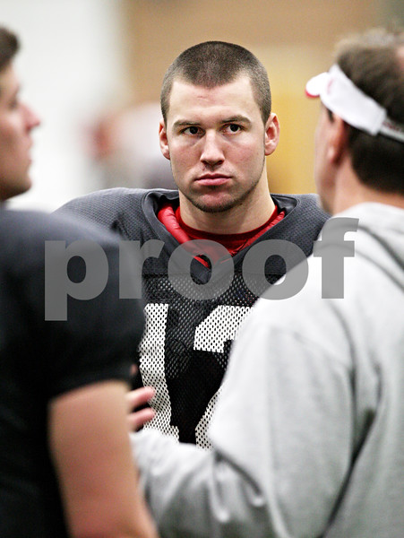 Beck Diefenbach  -  bdiefenbach@daily-chronicle.com<br /> <br /> Northern Illinois quarterback Chandler Harnish (12) during practice at the DeKalb Recreation Center in DeKalb, Ill., on Friday Dec. 12, 2009.
