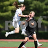 Beck Diefenbach  -  bdiefenbach@daily-chronicle.com<br /> <br /> Wheaton Academy's Crystal Thomas (left) heads the ball above Sycamore's Rachel Stueber (right) during the first half of the Class 2A state semifinal game at North Central College in Naperville, Ill., on Friday June 5, 2009. Sycamore lost to Wheaton Academy 5-2 and will face Chatham Glenwood for third place on Saturday.