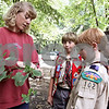 Wendy Kemp/For The Daily Chronicle<br /> Connie Handel, Outdoor Educator of Russell Woods, teaches the scouts, Jacob Handel, (left) Eric Gilmore (center) and Levi Moltz-Hohmann about different plants during Saturday's class on nature.<br /> Genoa 8/29/09