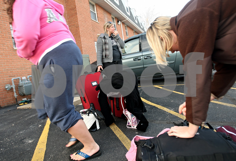 Beck Diefenbach – bdiefenbach@daily-chronicle.com<br /> <br /> Natalie Calcitrai, a Northern Illinois University students, waits by her luggage as her Alpha Delta Pi sorority sisters pack up the rest of their belongings before their road trip to Myrtle Beach, South Carolina, on Friday March 6, 2009.