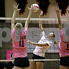 Rob Winner –  rwinner@daily-chronicle.com<br /> DeKalb's Courtney Thomas (12) looks to put one past Sycamore's Evyn McCoy (11) and Kaitlyn Roach (5) during the first game.<br /> 09/22/2009