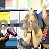 Beck Diefenbach  -  bdiefenbach@daily-chronicle.com<br /> <br /> (Left) Taliah Griffen, 4, gets ready to blow dry teacher Kourtney Johnson (center) while Brianna McCollum, 3, pours on the pretend shampoo during day care at the Children's Learning Center in DeKalb, Ill., on Monday Jan. 26, 2008.