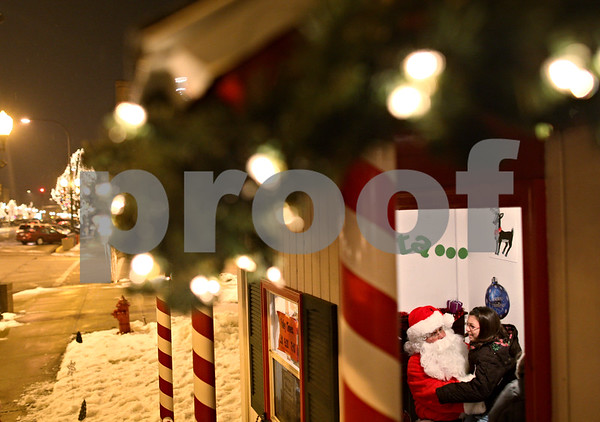 Beck Diefenbach  -  bdiefenbach@daily-chronicle.com<br /> <br /> Haley Snow, 9, of Sycamore, sits on Santa's lap at his post outside the DeKalb County Courthouse in Sycamore, Ill., on Friday Dec. 18, 2009. Snow asked Santa for an American Girl Doll.
