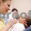 Beck Diefenbach  -  bdiefenbach@daily-chronicle.com<br /> <br /> Marisa Busch holds her new born son, Connor, during a baby shower party at Kishwuakee Community Hospital in DeKalb, Ill., on Friday May 8, 2009.