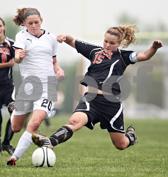 Beck Diefenbach  -  bdiefenbach@daily-chronicle.com<br /> <br /> Crystal Lake Central's Ellen Fairfield (15) and Sycamore's Katelyn Brown (20) battle for the ball during the second half of the Belvidere Class 2A sectional semi-final game at Belvidere High School in Belvidere, Ill., on Wednesday May 27, 2009.