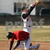 Beck Diefenbach  -  bdiefenbach@daily-chronicle.com<br /> <br /> DeKalb's Steven Karasewski (5) misses the catch which allows Batavia's Jordan Coffey (10) to slide in safe at second base the third inning of the game at DeKalb High School in DeKalb, Ill., on Wednesday April 15, 2009.