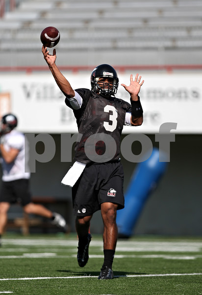 Beck Diefenbach  -  bdiefenbach@daily-chronicle.com<br /> <br /> Quarterback DeMarcus Grady (3) during practice at Huskie Stadium of Northern Illinois University in DeKalb, Ill., on Tuesday Sept. 1, 2009.