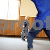 Beck Diefenbach  -  bdiefenbach@daily-chronicle.com<br /> <br /> Ian Dvorak, 7, rounds third base while playing indoor baseball with other children at the Kids Klub spring break program at the Genoa Park District building in Genoa, Ill., on Monday March 23, 2009.