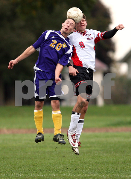Beck Diefenbach  -  bdiefenbach@daily-chronicle.com<br /> <br /> Indian Creek's Jon Kowalczyk (9, right) and Serena's Kevin Kreinbrink (20) leap for the ball during the second half of the class 1A regional match at Watermna Middle School in Waterman, Ill., on Wednesday Oct. 14, 2009. Serena defeated Indian Creek 1 to 0.