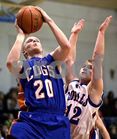 Beck Diefenbach  -  bdiefenbach@daily-chronicle.com<br /> <br /> Genoa-Kingston's Scott Suchy (20, left) shoots ball over Hinckley-Big Rock's Brian Michaels (12) during the second quarter of the game at H-BR High School in Hinckley, Ill., on Monday Dec. 21, 2009.
