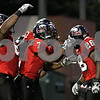 Rob Winner –  rwinner@daily-chronicle.com<br /> Chad Spann (28) is mobbed by his teammates after one of his three touchdowns on Saturday night. Northern Illinois defeated Western Illinois 41-7 in DeKalb on Saturday night.<br /> 09/12/2009