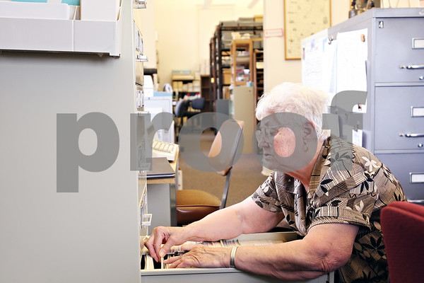 Beck Diefenbach  -  bdiefenbach@daily-chronicle.com<br /> <br /> Volunteer Jackie Tyrrell looks up documents concerning the early Sycamore settler Lysander Darling at the Joiner History Room in the Sycamore Library in Sycamore , Ill., on Thursday April 30, 2009.