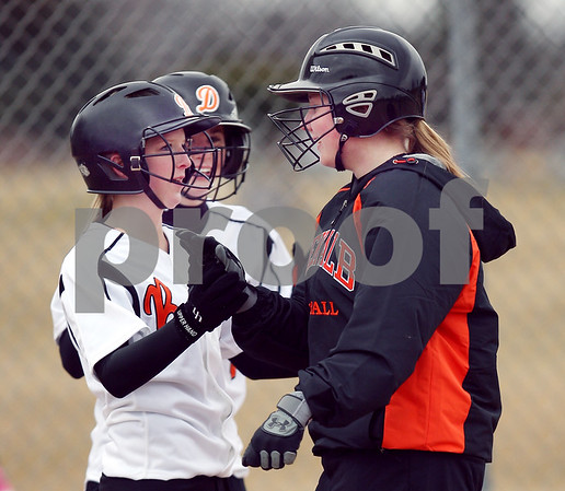 Beck Diefenbach  -  bdiefenbach@daily-chronicle.com<br /> <br /> From left, DeKalb's Carlie Varga (6), and Tia Lexa (5) congratulate Kristen Roenfanz (10) after she hit a three run home run in the bottom of the third inning of the first game in a double header against Elgin High School at DeKalb High School in DeKalb, Ill., on Monday March 23, 2009.