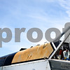 Beck Diefenbach  -  bdiefenbach@daily-chronicle.com<br /> <br /> Crop dusting pilot Nate Brown, left, waits in the cockpit during a quick fuel and fertilizer stop at Hendrickson Flying Service outside of Rochelle, Ill., on Monday July 27, 2009.