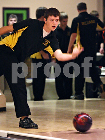 Beck Diefenbach  -  bdiefenbach@daily-chronicle.com<br /> <br /> Sycamore's Shane Toms rolls his ball during warm ups for a match at the Four Season's bowling alley in Sycamore, Ill., on Wednesday Dec. 2, 2009.